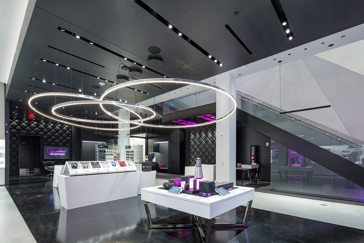 Magenta is everywhere at t mobile 39 s signature store on the for Mobel onlineshop design