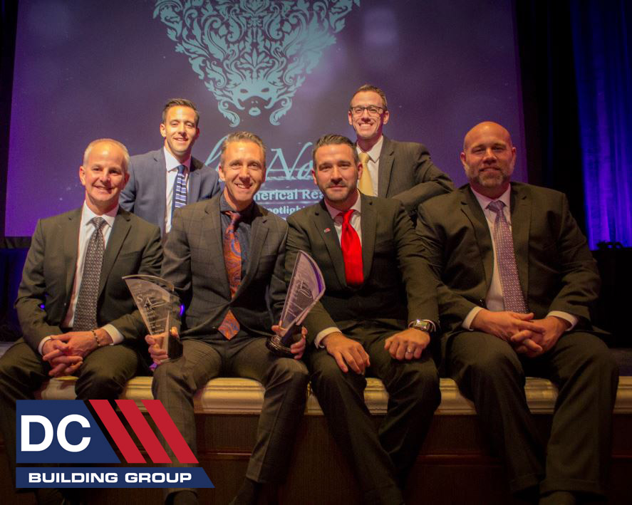 DC Building Group's Team accepted two Spotlight Awards from NAIOP; GC of the Year and T-Mobile Signature Store on The Strip