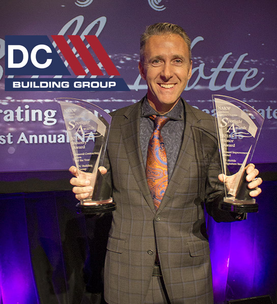Shawn Danoski with 2 NAIOP Spotlight Awards for GC of the Year and T-Mobile Signature Store Project